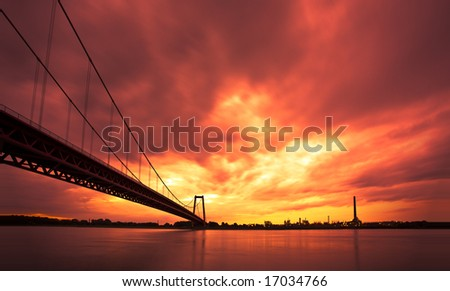 Long hanging bridge over the Rhine River in Emmerich, North Rhine-Westphalia, Germany - stock photo