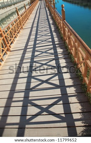 long lagoon bridge with the play of light and shadow - stock photo