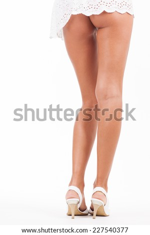 Long legs from behind isolated on white background