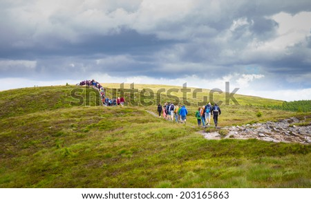 Long line of tourists in the Wicklow Mountains