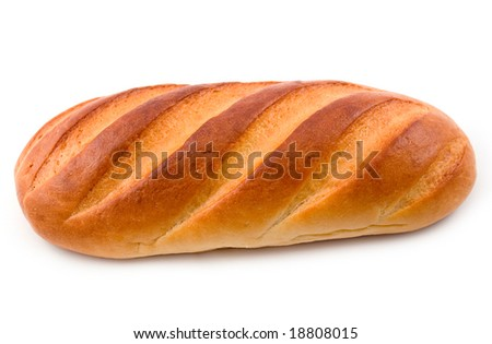 long loaf cut bread from wheat flour and fancy pastry on white background