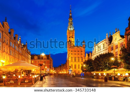 Long Market Street with Town Hall and Neptune statue  at night in Main City of Gdansk, Poland - stock photo