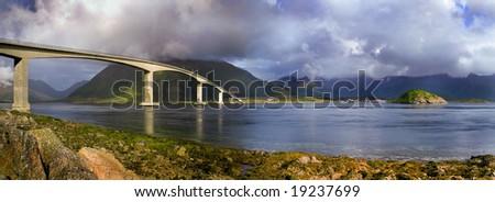 long modern bridge over fjord - stock photo