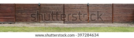 Long new solid wooden rural  fence made from brown pine logs. Isolated panorama from several photos - stock photo