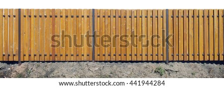 Long new solid yellow wooden rural fence from vertical pine planks. Isolated on white - stock photo