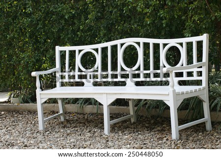 Long of white park bench - stock photo