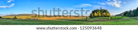 Long panorama in Sudeten Mountains with little forest - stock photo