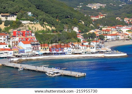 Long pier in front of fisherman harbor and town near the Ioanian sea, Greece