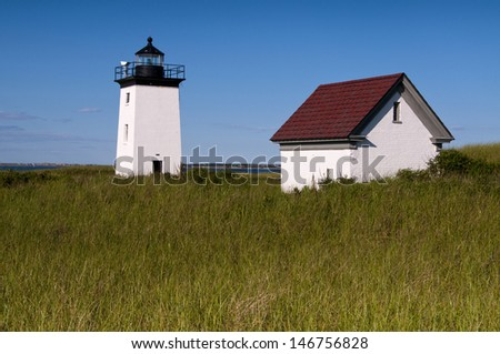 Long Point Light can be accessed from a long 3-mile hike along a jetty and soft sand from Provincetown, MA - stock photo
