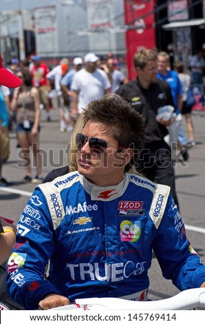 LONG POND, PA-JULY 6, 2013: Professional race driver Sebastian Saavedra greeting the crowd prior to qualifying for the Pocono 400 mile race at Long Pond on July 6, 2013.
