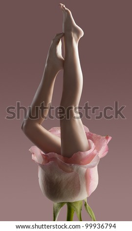 Long pretty bare woman legs isolated with a fashion light - stock photo