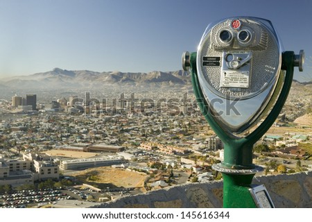 Long range binoculars and downtown of El Paso in Texas looking toward Juarez, Mexico - stock photo