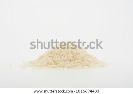 Long raw rice on white background