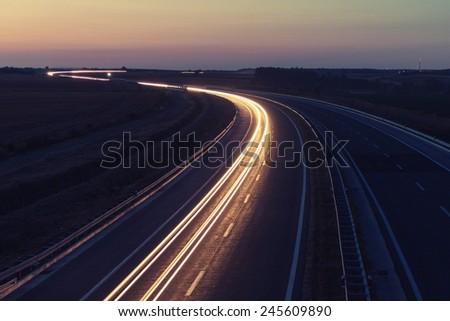 Long road at night - stock photo