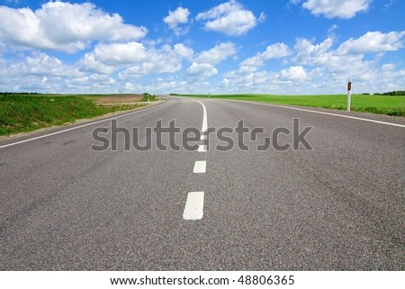 Long road stretching out into the distance - stock photo