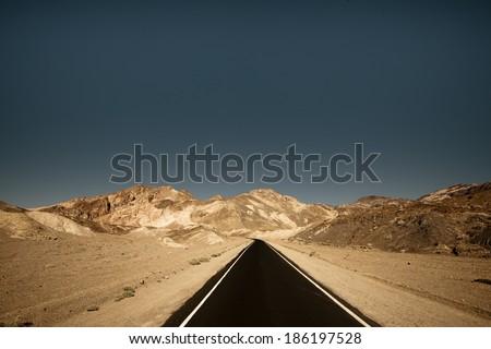 Long road surround by unique landscape - stock photo