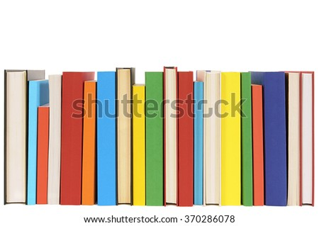 Long row of books isolated on white background .