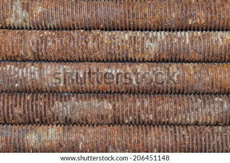 Long rusted bolts as background