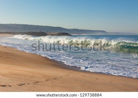 Long Sand Beach at morning. Nazare, Portugal - stock photo