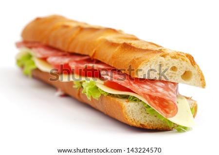 Long sandwich with  salami tomatoes isolated on white - stock photo