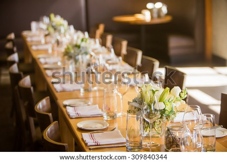 Long seated table at a party or event - stock photo