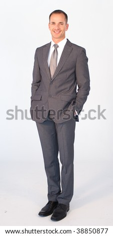 Long shot of an isolated businessman smiling at the camera - stock photo