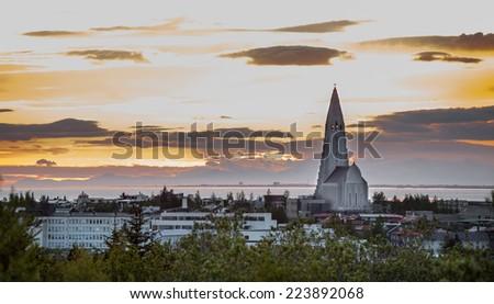 Long shot of Hallgrimskirkja church at sunset in Reykjavik, Iceland - stock photo