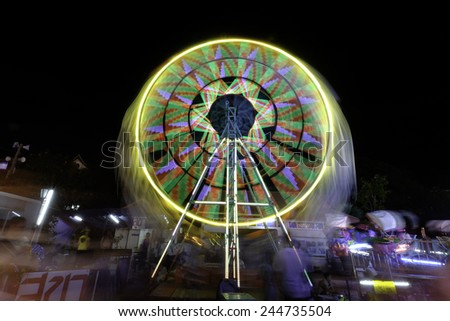 long shutter of Ferris wheel in temple fair, Thailand