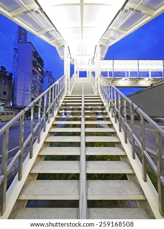 Long stair to footbridge - stock photo