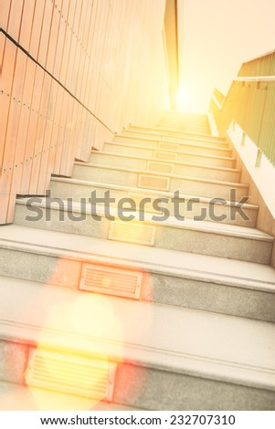 Long stairs up to modern building with sunshine