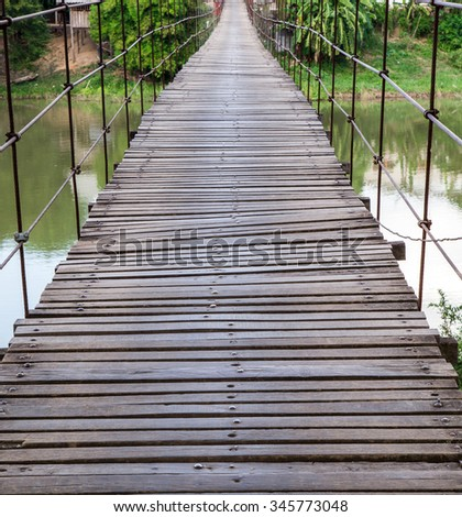 Long Steel Suspension bridge, at Ayutthaya, Thailand