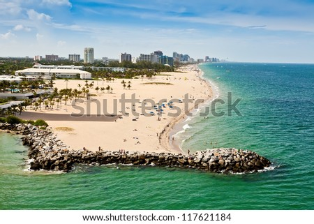 Long stretch of Ft. Lauderdale Beach in Florida with sandy beaches and numerous hotels and resorts. - stock photo