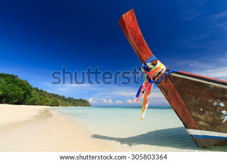 Long tail boat against blue sky and sea. Koh Rok island, Krabi, Thailand. - stock photo