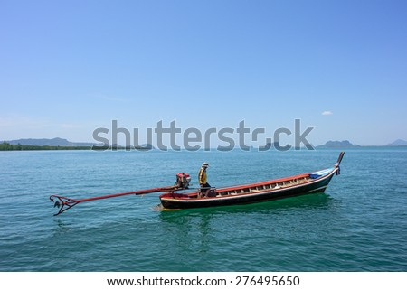 Long tail boat and blue sea, Traditional Thai Boat at Trang, Thailand.