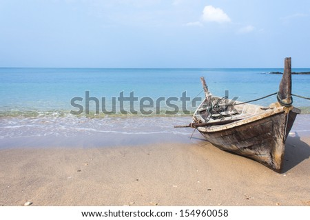 Old fishing boat stranded on beach stock photo 256171933 for Long beach fishing boat