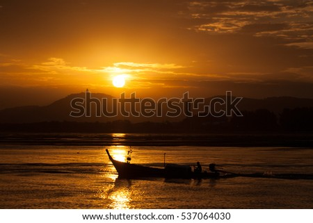 Long tail boat in sunset, Phuket, Thailand