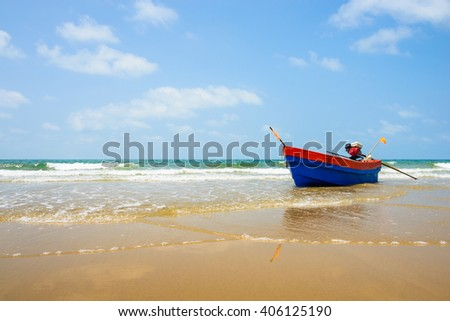 Long tail boat in tropical sea on blue shade sky background