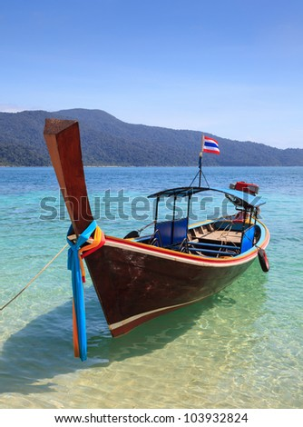 long tail boat sit on the beach, Rawi island, Thailand - stock photo