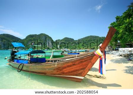 Long tail boats in Phi Phi Island, Krabi, Thailand. - stock photo