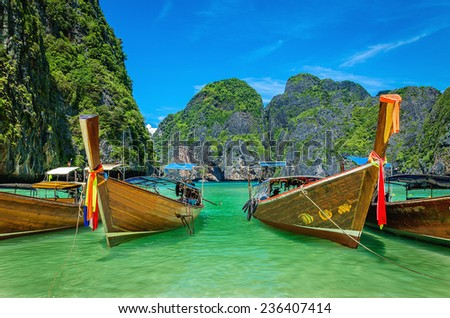 Long tail boats on famous Maya Bay on Phi Phi Islands, Thailand - stock photo