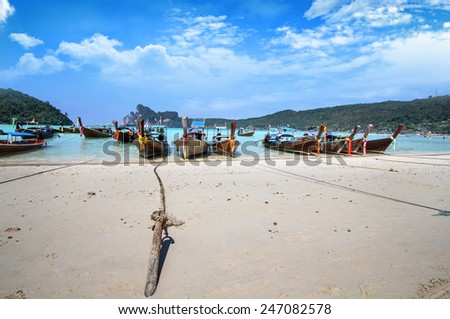 Long tail boats on Phi Phi Islands, Thailand - stock photo