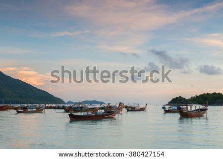 Long tail boats with sunrise sky in Koh Lipe Island