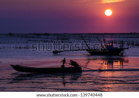 Long tail Fishing boat and sunset , Twilight, Thailand