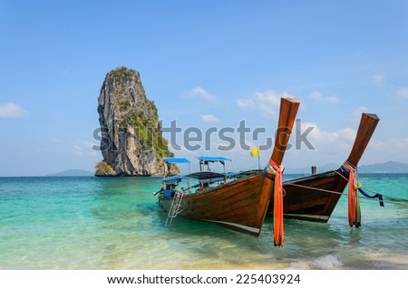 Long-tail Taxi boat on the beautiful beach, krabi,South Thailand - stock photo