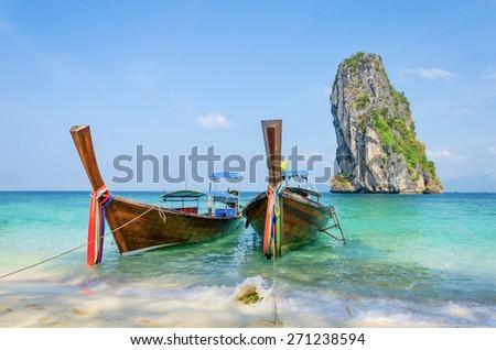 Long-tail Taxi boat on the beautiful beach, krabi, Thailand - stock photo