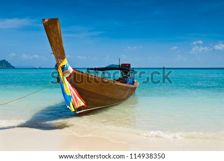 Long tailed boat at Phiphi island, Thailand - stock photo