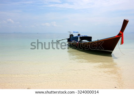 Long-tailed boat on Pattaya beach (Bundhaya) Koh Lipe Thailand. - stock photo