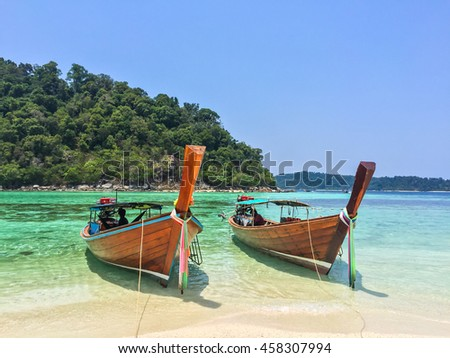 Long tailed boat or Ruea Hang Yao in the emerald green water sea at Lipe Thailand.