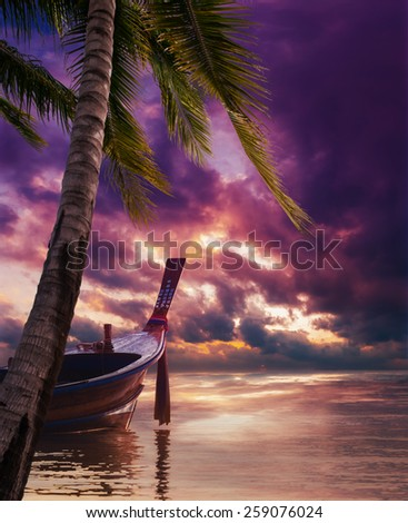 Long tailed boat  Ruea Hang Yao at sunrise in Phuket Thailand - stock photo