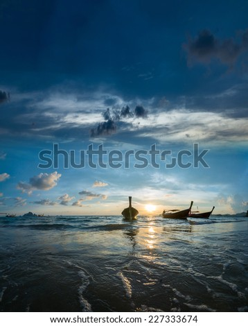 Long tailed boat Ruea Hang Yao at sunset in Krabi Thailand